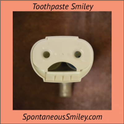 Bottom of Mentadent (toothpaste) Smiley
