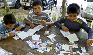 Kevin, Anthony and Arnaldo color to help them pass the time waiting to hear if they will get surgery.