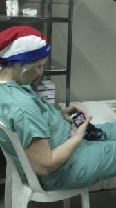Dr. Susan, a surgeon from Paraguay, plays solitaire on her cell phone between surgeries. i LOVED seeing this. How wonderful that she took time to play! how lovely that play helped her during san emotional and stressful day changing the lives of children!